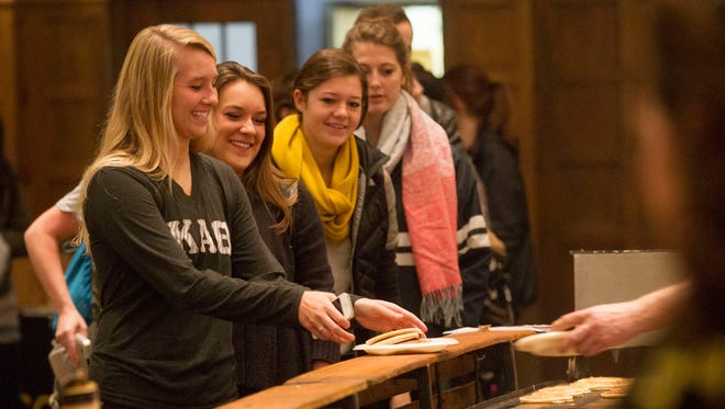 University of Iowa students line up for a free pancake breakfast at the Iowa Memorial Union on Monday, Dec. 15, 2014. David Scrivner / Iowa City Press-Citizen