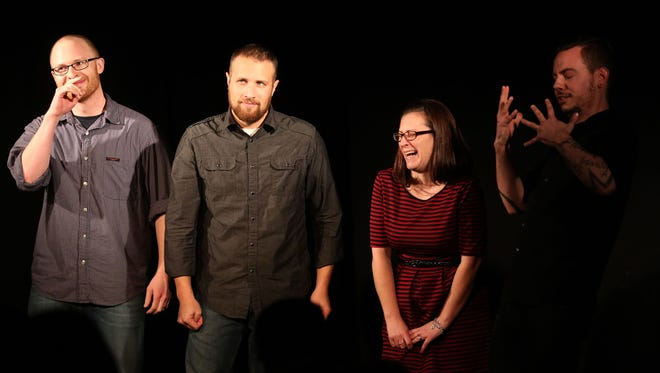 Audience volunteer Jacinda Hoffman-Sanders of Albany (second from right) performs with improvisors Dave Sundby (from left), Jared Richard and Reverend Buerge during an improv comedy show at the Capitol City Theater in Salem on Saturday, Jan. 24.