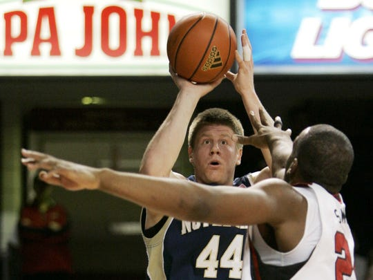 Notre Dame's Luke Harangody shoots over Louisville's Samardo Samuels during the first half of their NCAA college basketball game in Louisville, Ky., Monday, Jan. 12, 2009. (AP Photo/Ed Reinke)