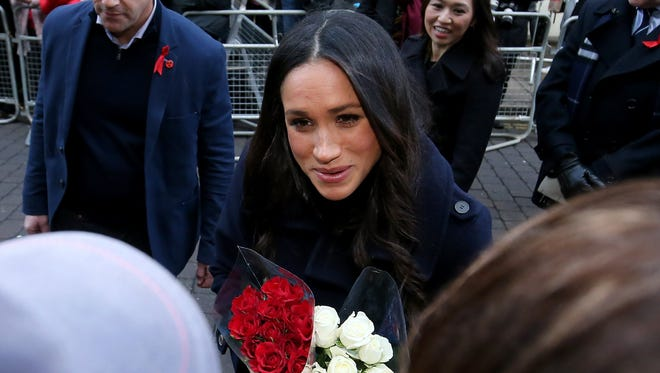 Britain's Prince Harry (unseen) and his fiancee U.S. actress Meghan Markle visit the Terrence Higgins Trust World AIDS Day charity fair at the Nottingham Contemporary, Britain, Dec. 1, 2017.