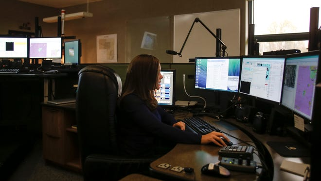 Eaton County 911 dispatcher Cassandra Yarger works Wednesday, Oct. 11, 2017, at the dispatch center in Charlotte.    Yarger has been a dispatcher for six years.