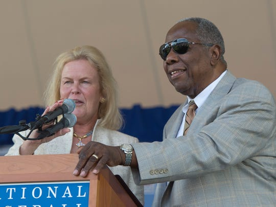 Jul 27, 2014; Cooperstown, NY, USA; National baseball hall of fame chairman of the board Jane Forbes Clark asks Hall of famer Hank Aaron (right) questions at a break during the class of 2014 national baseball Hall of Fame induction ceremony at National Baseball Hall of Fame. Mandatory Credit: Gregory J. Fisher-USA TODAY Sports