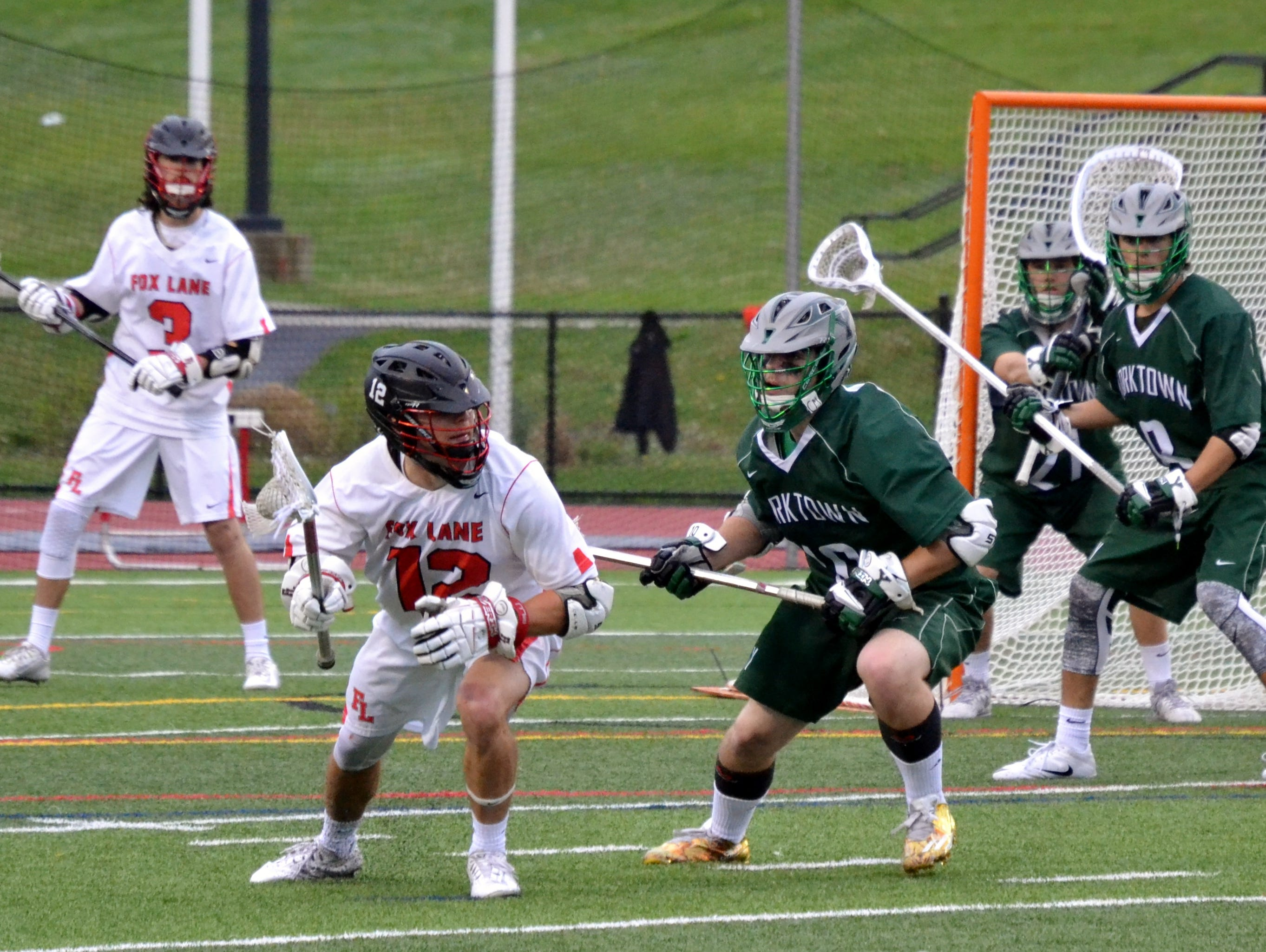 Fox Lane's Cullen Morgan spins, looking for room during an 8-6 loss to Yorktown on Thursday.