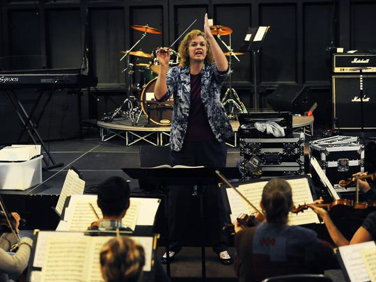 The Reno Pops Orchestra, led by conductor Jane Brown, rehearses on Jan. 8 at JamPro Music Factory for an upcoming fundraiser. The orchestra will play Poppin' Pistons at 6 p.m. Jan. 31 at the National Automobile Museum.