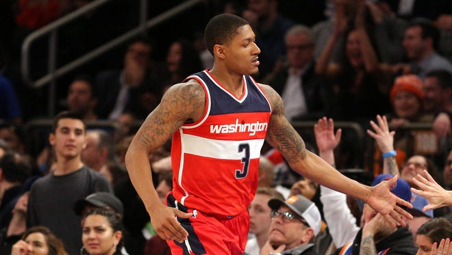 Washington Wizards shooting guard Bradley Beal high fives fans after a shot during the fourth quarter against the New York Knicks at Madison Square Garden.