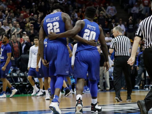 Middle Tennessee State's JaCorey Williams and Giddy Potts reacts after an NCAA college basketball tournament second-round game against Butler Saturday, March 18, 2017, in Milwaukee. Butler won 74-65. (AP Photo/Morry Gash)