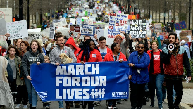 March For Our Lives protestors walk downtown near Public Square Park on Saturday, March 14, 2018, in Nashville Tenn. They are protesting gun violence in schools after 17 people, including students and faculty members, were killed at Marjory Stoneman Douglas High School in Parkland, Fla., in February. Nashville's march was organized by Abby Brafman, a freshman at Vanderbilt University who graduated from the Florida high school.