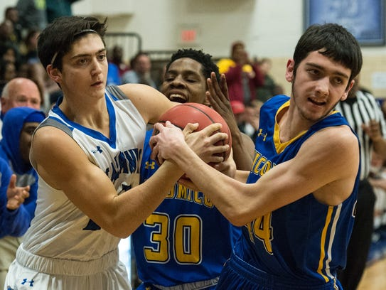 Decatur's Ryan Danaher (12) fights for possession with