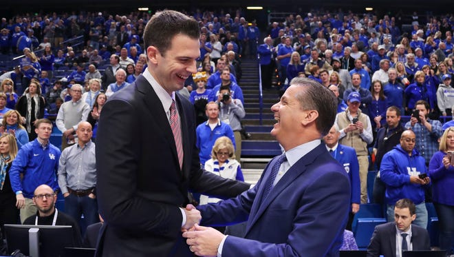 "Kentucky's John Calipari greeting Louisville's David Padgett before the game Dec. 29, 2017: ""David has done a good job with this team (but) they hit us on a bad night. "" The Wildcats rolled past the Cardinals 90-61."
