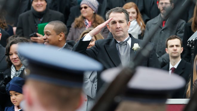 Gov. Ralph Northam salutes the Virginia Military Corp of Cadets during inaugural ceremonies at the Capitol in Richmond, Va., Saturday, Jan. 13, 2018. Northam is a graduate of the school. (AP Photo/Steve Helber)