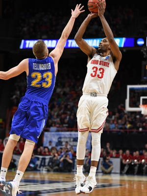 Mar 15, 2018; Boise, ID, USA; Ohio State Buckeyes forward Keita Bates-Diop (33) shoots as South Dakota State Jackrabbits guard Reed Tellinghuisen (23) guards in the first half during the first round of the 2018 NCAA Tournament at Taco Bell Arena. Mandatory Credit: Kyle Terada-USA TODAY Sports