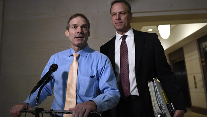Rep. Jim Jordan, R-Ohio, left, and Rep. Scott Perry, R-Carroll Township, speak to reporters on Capitol Hill on Thursday.
