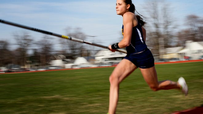 Port Huron Northern junior Mackenzie Shell competes in the pole vault during a meet in the 2014 season at Port Huron High School.