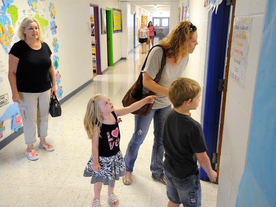 Linda West (from left) watches as her granddaughter, Brooklin Knight, daughter, Lizabeth Knight, and grandson, Sebastian Knight, check out a classroom at Amanda Gist Elementary School in Cotter last week. The family was checking out the school where Sebastian will be attending first grade. The first day of school at Cotter is Monday.