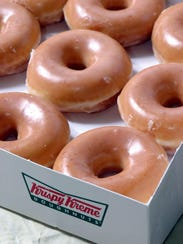 Krispy Kreme is giving away free doughnuts on Friday,