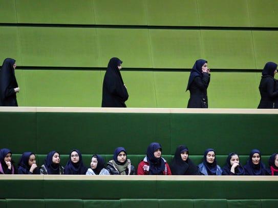 Iranian schoolgirls attend President Hassan Rouhani's