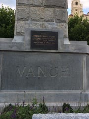 By some accounts, a small nick on the Vance Monument, visible down and to the left of the letter 'V,' was caused by a stray bullet in a 1906 downtown shootout that left five men dead.