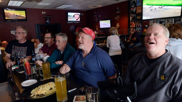 Jon Bot (far right) watches the 2014 Belmont Stakes with regular customers at Botski's on the east side of Sioux Falls.