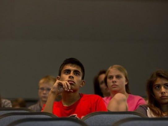 Students watch as Renee Napier and Eric Smallridge