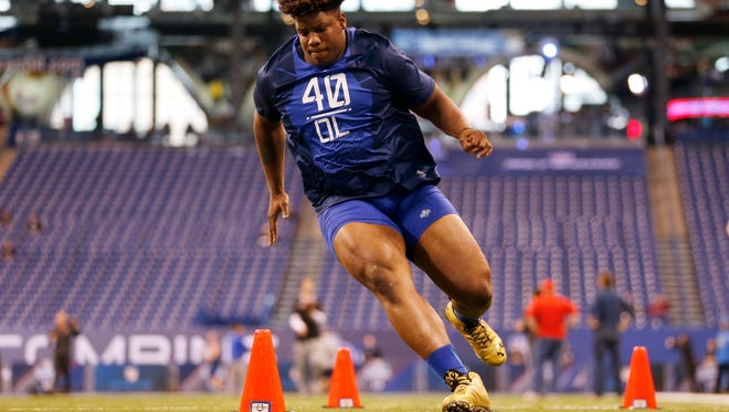 TSU offensive lineman Robert Myers runs a drill at the NFL Combine on Friday.