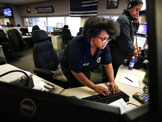 Memphis 911 supervisor Beverly Wolfe-Davis fields calls at the city's call center. The city has had success bringing in part-time and former dispatchers to get response times down while it trains new staff.