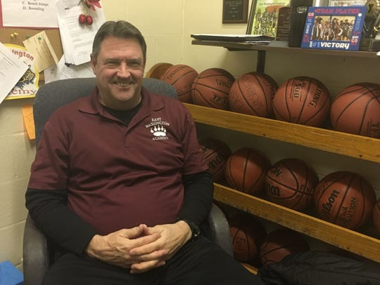 Ron Howell sits in his office at East Washington Academy.
