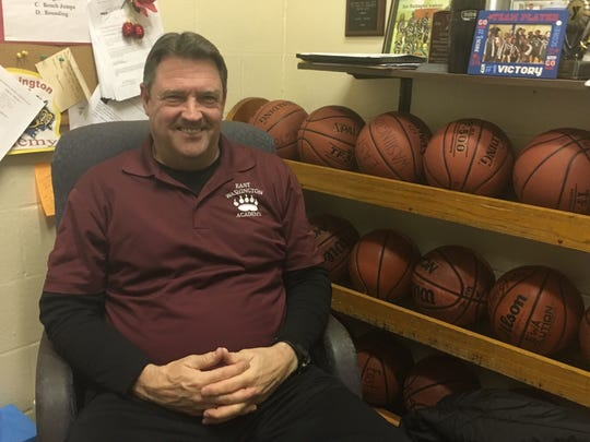 Ron Howell sits in his office at East Washington Academy. Howell is the new girls basketball coach at Central.