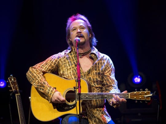 Country singer Travis Tritt appears at the Lyric Theatre in Stuart, Florida, in 2013. The multiplatinum artist and Grammy winner will shed his band for an acoustic show Jan. 14 at Memorial Auditorium.