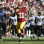 Redskins running back Matt Jones (31) outpaces the New Orleans Saints' defense to score a 78-yard touchdown during the first half of Sunday's game in Landover, Md.