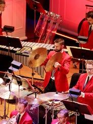 Michael Culligan, percussionist with the Cincinnati Symphony Orchestra, plays the cymbals at a recent Cincinnati Pops concert.