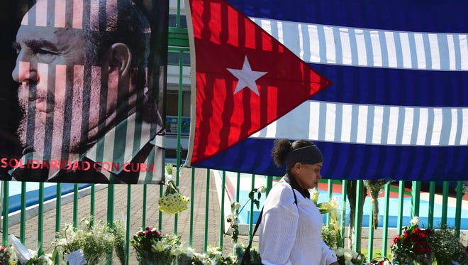 A woman walking outside the Cuban embassy in Mexico City on Nov. 28, 2016, two days after Fidel Castro's death.