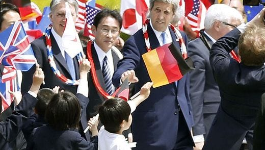 Japan's Foreign Minister Fumio Kishida and U.S. Secretary of State John Kerry are sent off by children after offering wreath at the Hiroshima Peace Memorial Park.
