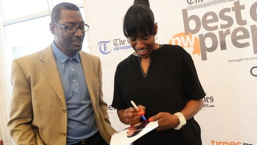 Jackie Joyner-Kersee signs autographs at the Best of Preps banquet Tuesday evening at the Shreveport Convention Center.