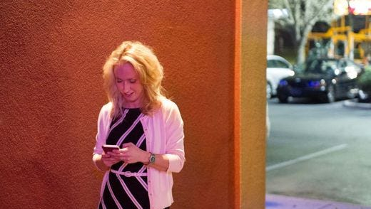 Miranda DeBruhl fields phone calls after her win in the Republican primary for chair of Buncombe County Board of Commissioners earlier this year.