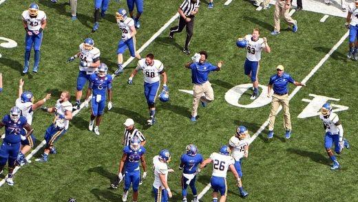SDSU football players celebrate their win over Kansas