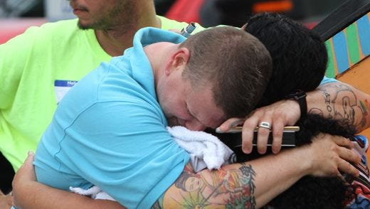 Ben Johansen grieves at The Center, a LGBT community center in Orlando.