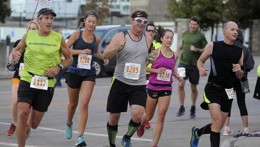 Runners make a turn at the 2015 Sioux Falls Marathon