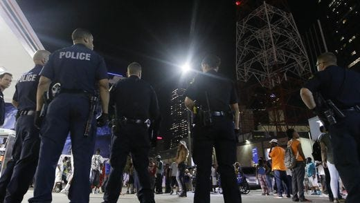 Dallas police gather as a crowd forms in downtown Dallas in the early morning on July 8, 2016.