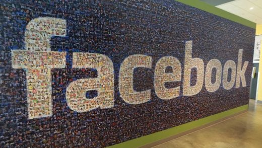 A board with the Facebook logo seen inside the new Facebook data centers on Friday, Nov. 14, 2014, in Altoona.