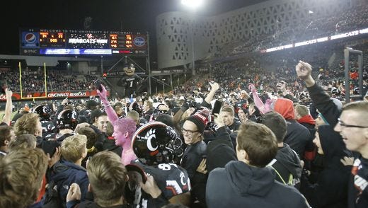 UC students stormed the field last season after the Bearcats upset the Miami Hurricanes at Nippert Stadium.