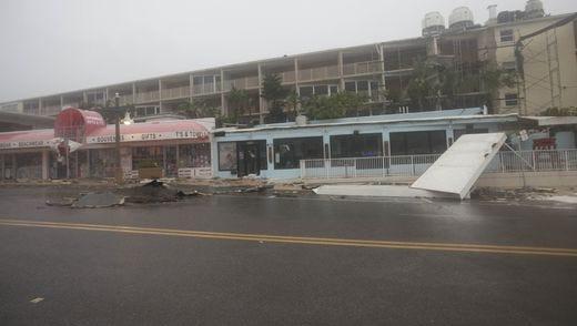 Some damage is visible near the Daytona Inn on Daytona Beach, Fla., on Oct. 7, 2016, as Hurricane Matthew roars off shore.