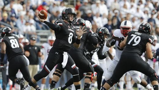 Cincinnati  quarterback Hayden Moore threw the ball 56 times against UConn, with UC unable to generate a running game.