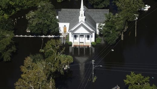 A boat passes a church in Nichols on Oct. 10, after the passing of Hurricane Matthew.