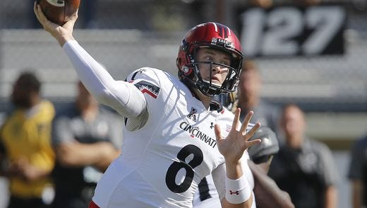 Hayden Moore started at quarterback for the Cincinnati Bearcats last week, but it remains unclear whether Moore or Gunner Kiel will start Friday against Memphis.