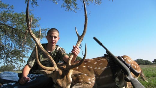 Air Force Academy nominee Dillon Reynolds of Ruidoso, a top scholar and athlete at NMMI, is also a long time avid hunter. He poses here with a trophy shot during a 2013 hunt.