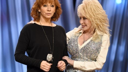 "Reba McEntire, left, and Dolly Parton chat during the telethon ""Dolly Parton's Smoky Mountains Rise: A Benefit for the My People Fund"" Tuesday, Dec. 13, 2016, in Nashville, Tenn."