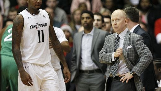 University of Cincinnati forward Gary Clark visits with coach Mick Cronin during Thursday's 93-91 overtime win over Marshall. Clark scored a career-high 26 points in the game.