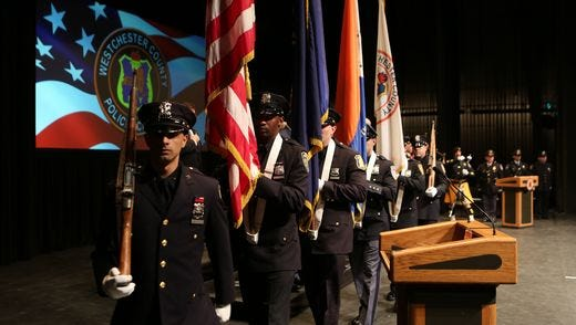 New Rochelle police officer Harry Kyreakedes graduated from the Westchester County Police Academy in December 2015. Shown here are fellow members of his graduating class on Dec. 18, 2015 at Purchase College, SUNY.