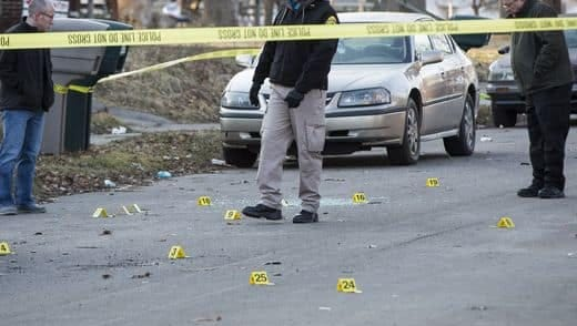 City police officers at the scene of an early Sunday homicide on South Pershing Drive.