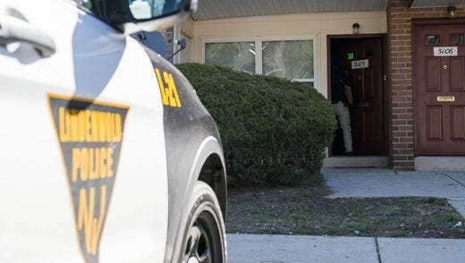 A Lindenwold police car sits outside an apartment where twin infants were found unresponsive on March 22.
